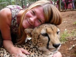 K.C. snuggling a cheetah