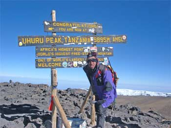 Made it. Haggard Kwameh next to the famous signboard at Uhuru Peak Kilimanjaro!