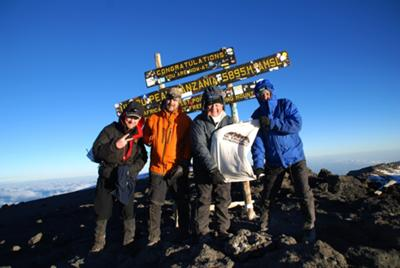 The four of us at the top of Kilimanjaro